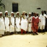 Most of the Akomfo of Anomabu, gathered outside in white garments before participating in a procession through town (click for full image)