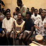 The Cantors seated to perform while the Chorus plays the Ampaa Drum