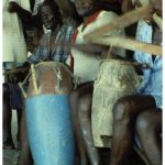 An Odenkese group of Anomabu perform while seated
