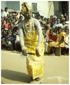 A komfo of Anomabu during a ceremony, performing in front of a crowd
